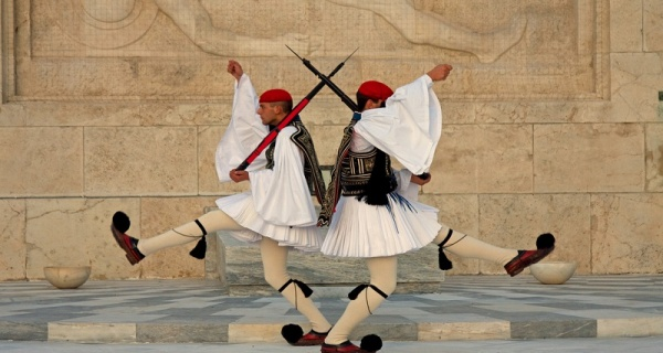 Evzones performing the changing-of-the-guard ceremony and guarding the the Tomb of the Unknown Soldier in front of the Greek Parliment Building in Syntagma Square, Athens, Greece.